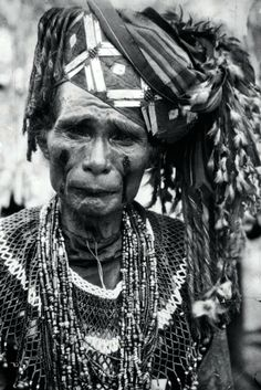 A Toraja shaman wearing a round bead collar and several bead necklace.  ca. 1930   |||  Source; page 12, Ethnic Jewelery from Indonesia ~ http://issuu.com/edmbooks/docs/ethnic_jewellery_from_indonesia