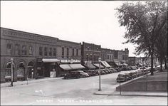 RP, Street Scene, Many Business: Erickson, Abstract, Drugs, Etc., Barron, Wisconsin, 1930-1950s