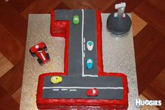 For a boy who loves all things cars, a first birthday cake in racer style was created!
