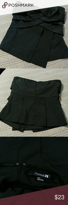 Forever 21 black strapless top Classy little black top, strapless, zipper in back.  Lightly used, a great addition to your wardrobe.  No stains or tears, non smoking home. Forever 21 Tops
