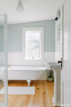 The colours of nearby Kakanui Beach inspired the palette in this renovation. The tongue-and-groove panelling is painted in Resene Half Black White beneath walls in Resene Duck Egg Blue. The ceiling, architraves and door are in Resene Eighth Parchment. Blue Green Bathrooms, White Bathroom, Modern Bathroom, Duck Egg Blue Bathroom Tiles, Blue Bathroom Paint, Downstairs Bathroom, Heritage Bathroom, Half Painted Walls, Bathroom Paneling