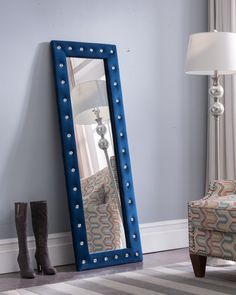 <p>Kings Brand Furniture Modern Upholstered Tufted Standing Floor Mirror, Blue Velvet. </p><p>This velvet upholstered frame is tufted with shiny crystal accents that bring a bit of sparkle into your living area. </p><p>The durable wood frame allows you to stand this mirror against a wall for easy viewing. </p><p>Use this tall rectangular floor mirror before leaving the house or before a date. </p><p>Dimensions: 22.25&qu...