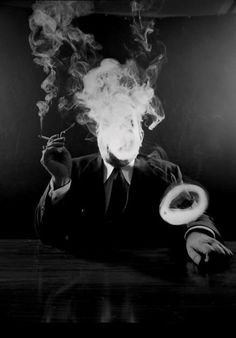 I just love this picture. If I ever tried smoking, it would be solely for the appeal of learning to blow smoke rings.