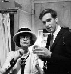 Coco Chanel with photographer Douglas Kirkland in a dressing room, 1962