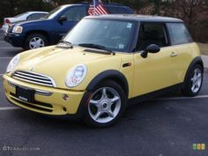 Yellow Mini Cooper... I love these little cars