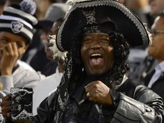 An Oakland Raiders fan enjoying the season opener NFL football game between the San Diego Chargers and Oakland Raiders at Oakland-Alameda County Coliseum on September 2012 in Oakland, California. The Chargers won the game Oakland Raiders Football, Nfl Football Games, Football Fans, Nfl Raiders, San Diego Chargers, Nfl Season, Raider Nation, Nfl News, Fitness Gifts