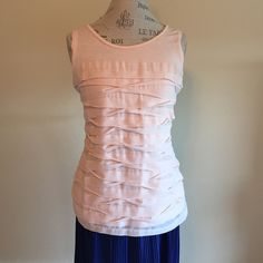 Ann Taylor sleeveless top NWOT Light pink jersey tank style top.  Front has sheer layered tiers to make this a very feminine alternative to a plain tank.  Could be dressed up or down. Ann Taylor Tops