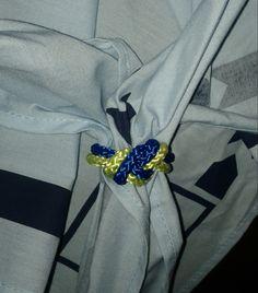 Cubs scout neckerchief slide using a slip knot.