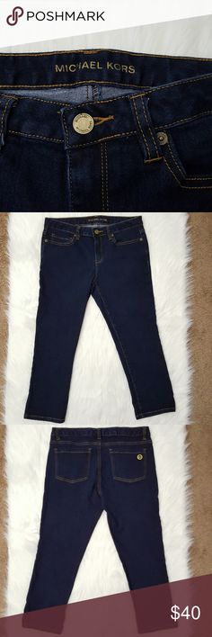 "Michael Kors crop jeans Size 6 Size 6 jeans in dark wash. 5 pockets. Gold MK logo on back right pocket. Like new condition. Flat lay measurements: Approximately 15.5"" waist, 8.5"" rise, 22"" inseam. Michael Kors Jeans"