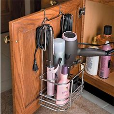 10. Cord control. Hair dryers, electric shavers, and flat irons have a way of getting in the way. A hanging organizer for the vanity door easily keeps those unruly cords in control. This particular organizer from HSN is sold out, but a small shower caddy or trimmed shoe organizer would do the trick.