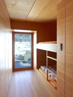 A small 16mq cabin was converted in a stylish holiday house. The exterior  surfaces weren't changed and inside a larch skin covers the whole surfaces. ARCHITECTURE