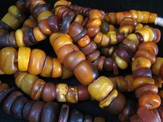 About 300 grams of moroccan natural antique amber in two strands. Small to medium size. More pictures available.  On hold.