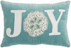 Joy Christmas pillow with sand dollar design: http://www.completely-coastal.com/2015/11/sea-inspired-coastal-christmas-collections.html