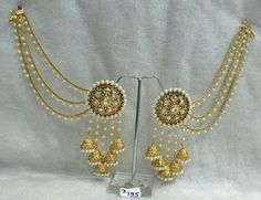 These stylish Jhumka Earrings set from Pahal Creations will certainly leave you spellbound. These Jhumka Earrings set have an excellent finish and gives out an exquisite sense of style. Beautiful Gold Tone Jhumka Earrings with White Pearl Simulant. Royal Jewelry, Chanel Jewelry, Jewelry Sets, Fashion Jewelry, Jewelry Stand, Jewelry Holder, Jewelry Stores, Jhumki Earrings, Indian Earrings