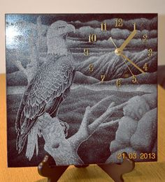 Black granite Wall Mounted or Wall Hanging sculpture by artist Zbigniew Pietrzak titled: 'Hand Etched Eagle - Clock (Wall)'