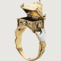 Jewish wedding ring, 19th century.  The symbolism of clasped hands or a heart on a betrothal or wedding ring is a Western European tradition, but  the clasping of an architectural structure is an iconographic feature characteristic of Jewish marriage rings.