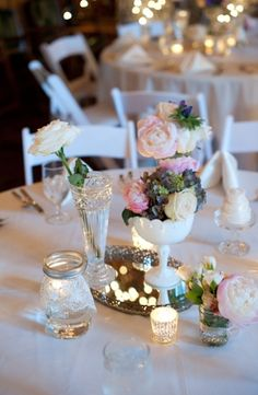 Vintage milk glass, mason jars, and a mirror tray - lovely wedding centerpiece