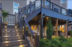 As an underdecking option, Trex Rain Escape expands your outdoor space by allowing rain to flow through the system and onto the ground or into a rain storage system. You can then use the space beneath your deck. Patio Under Decks, Decks And Porches, Under Deck Landscaping, Patio Deck Designs, Patio Design, Walkout Basement Patio, Deck Stairs, Deck Builders, Deck Lighting