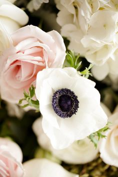 Wedding Flowers -- Anemones & Blush Pink Roses -- See the wedding on #SMP here: http://www.StyleMePretty.com/2014/04/30/black-white-blush-seaside-wedding/ Photography: AshleeRaubach.com