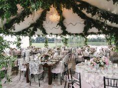 Garland-Draped Ceiling | 20 Unexpected Wedding Flower Ideas | https://www.theknot.com/content/unique-wedding-flower-ideas
