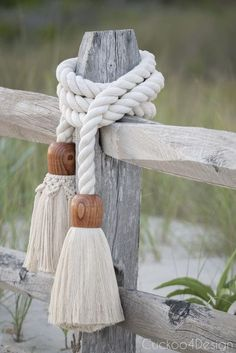 Find out how to make this show-stopping giant cotton rope macrame tassel garland that you can use as a railing or home accessory | giant macrame tassel | wood and macrame tassel | wood tassel | cotton rope tassel | staircase railing | beach home decor | tassel DIY | boho home decor | bohemian home decor accessory | how to make a giant tassel | giant cotton tassel | using wood cups to make a tassel | rope tassels | twisted cotton rope tassels | thick white cotton rope tassel