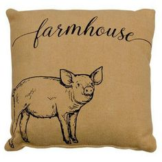 "Farmhouse Pillow - Our Farmhouse Pillow is a tan burlap fabric pillow. Pillow features a sketched pig design and displays the word ""farmhouse"" in black script. Charming accent pillow for your country, rustic, or farmhouse decor.  Dimensions: 10"" square"
