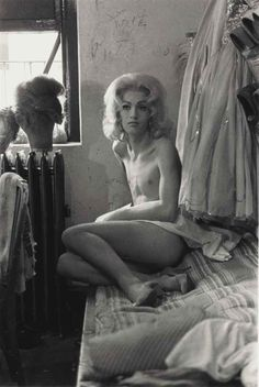 Diane Arbus, Female Impersonator on a Bed, N.Y.C., 1961 - I love this photo and many others of Arbus because the people she photographs are all peculiar and not the people normally seen in portrait photography.