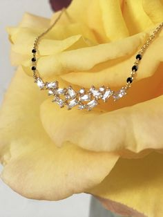 A designer diamond mangalsutra pendant made with gold pendant and mangalsutra chain. G/H color, VS clarity, real, high-quality diamonds. Diamond Mangalsutra, Gold Mangalsutra Designs, Gold Jewellery Design, Diamond Jewelry, Mangalsutra Bracelet, Diamond Necklaces, Black Jewelry, Gold Jewelry, Jewelry Rings
