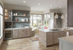 Warm modern kitchen featuring Medallion Cabinetry's Bella door in Quartersawn Oak with Cobblestone finish and Mission door in Maple with Chai Latte Classic finish. Also shown (far left) is the Bellagio Stainless Steel Door with Frosted Glass.