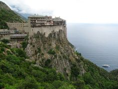 https://flic.kr/p/nYqUgN | As daring as one can build: Simonos Petras Monastery, Σιμωνόπετρα, Mount Athos | Built on a giant rock 330 metres above the Aegean Sea, the monastery of Simonos Petras is undoubtly the most spectacular building on the peninsula that makes up Mount Athos. Look, to get a better idea of the scale, at the boat down in the depths, that is actually a small ferry...simply a breathtaking construction that has already been standing for many centuries...
