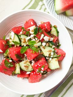 Minty watermelon & cucumber salad. A refreshing summer salad with sweet watermelon, cool cucumber, feta, crunchy sunflower seeds, and fresh mint.