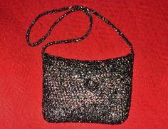 Crocheted VHS tape handbag with strap
