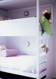 I would have a slit/holes/etc. cut in the upper bed safety rail so the child could see out without hanging over the top