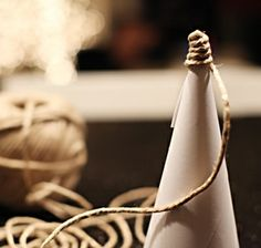 Make little cone Christmas trees with rope.