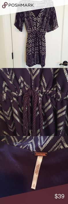 💗FREE PEOPLE💗 Purple & Silver Metallic Dress 💗FREE PEOPLE💗 Purple & Silver Metallic Dress / Tag Size = Small / Flowy Breezy Material/ Can fit from a Small to a Lare with Drawstring / Super cute Over jeans or leggings! Free People Dresses