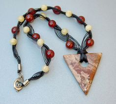 The unique jasper triangle gemstone pendant dangles on the handmade knots macrame beaded necklace. The macrame necklace made with waxed threads of black color and Natural Gemstone round Loose Beads in carnelian and natural colors finished off with si #gemstone, #gem, #fine #gem #best, #most, #top, #hot, #cool, #beautiful, #coolest, #amazing, #awesome, #elegant, #jewellery, #jewelled, #luxury. click #ruby #case http://bit.ly/