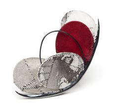 Solstice 2012.  Brooch by Myung Urso.  Cotton, silk, Asian ink, thread, sterling silver, lacquer