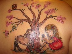 """The Family Branches  """"I got this tattoo from Faith Tattoo Gallery in Golden, CO. It is for my daughter and my family. I wanted something pretty and timeless and I love trees. My daughter is under the tree and her birthday is in her shoe. There are initials carved in the tree for my parents, siblings, sister-in-law, my daughter and my niece and nephew. The owl is a symbol from my childhood of wisdom and family."""" -- Vera Widmar, mother TK, 3, of Northglenn, Colorado"""