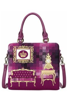 The front of the Vendula Downton Grab Bag features a stunning applique vintage sofa with gold and pink tartan detail. An old clock is picked out in applique detail on top of a gold dressing table adding to the period inspired style while the luxury gold embroidery details gives this bag a very elegant feel. Pink tartan with a deep magenta woolen trim as the background. The purple version has a full woolen fabric back.The base and sides of this bag are made from matching faux leather, as are…