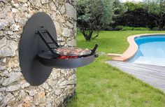 Folding grill! What an excellent idea... it folds away neatly against the wall!