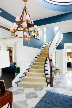 Staircase Runner. Jute Staircase Runner. The front door opens to a grand foyer with plenty of classic millwork and a timeless curved staircase with jute runner. Staircase Runner. Natural fiber Staircase Runner. #StaircaseRunner #Staircase #Runner #juterunner #Naturalfiberrunner Echelon Custom Homes