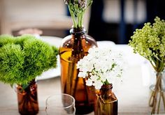 Love the white and green in the amber glass bottles for wedding centerpieces, so pretty!