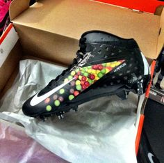 Beast Mode has his own Skittles Cleats now!!
