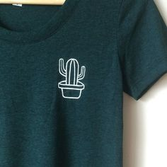 This tri-blend polyester, cotton & rayon t is so soft, you'll never want to take it off. This forest green shirt features a small patch cactus design, and is so perfect for daily wear. *Color may diff (Top Design Shirts) Mode Style, Style Me, Shirts & Tops, Blue Shirts, Funny Shirts, Diy Clothes, Printed Shirts, Graphic Tees, Shirt Designs