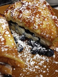 Blueberry Stuffed Egg Nog French Toast! Serving this on my New Year Day Buffet!