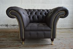 Traditional British handmade deep buttoned Chelsea Chesterfield Chair, shown in chocolate brown leather. Large chair. | Abode Sofas