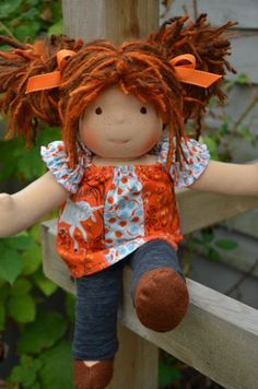 This is Maddie. She has sunkissed skin, long hair made with mohair and wool yarns in a brown and ginger color with dark ginger mohair and regular brown dreadlocks and brown eyes. She is wearing the pictured outfit, underpants and wool felt shoes.