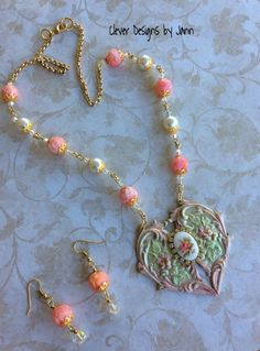 Vintage Flair Heart Necklace and matching Earring ..  A beautiful Heart is painted and attached to it is a rose cab with rhinestone around it ..  rose beads, pearls, crystals, bead caps and gold chain complete this beauty ..FOR SALE $48.00 https://www.etsy.com/shop/CleverDesignsbyJann .. SOLD
