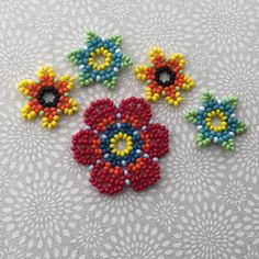learn how to make huchol inspired beaded jewelry with daisy flowers, stars and large flowers.
