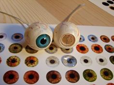 Customize inexpensive plastic eyeballs with different eyecolor.
